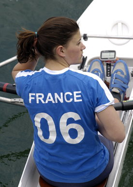 Photo of a woman sitting in boat with French top