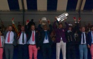 The mens eight lift The Grand Challenge Cup