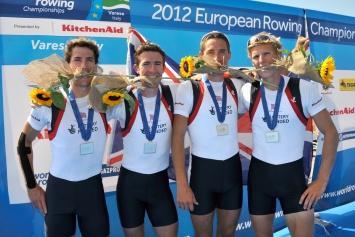 Silver medals and sunflowers for the GB LM4- of (L to R) Scrimgeour, Freeman-Pask, Fletcher and Clegg in Varese