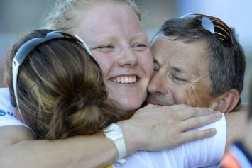 Hug for Polly Swann from coach Robin Williams and Helen Glover