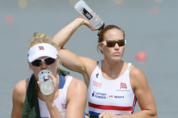 Polly Swann (left) and Helen Glover cool off before their heat this morning