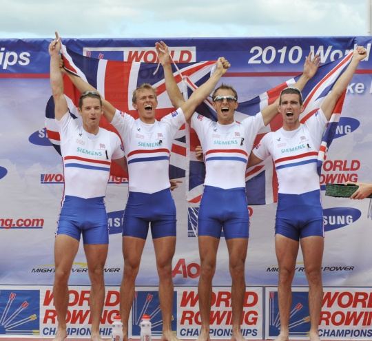 Williams (second left) celebrates his 2010 World Title