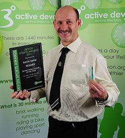 Image of Kevin Sellar with Devon Sports Award