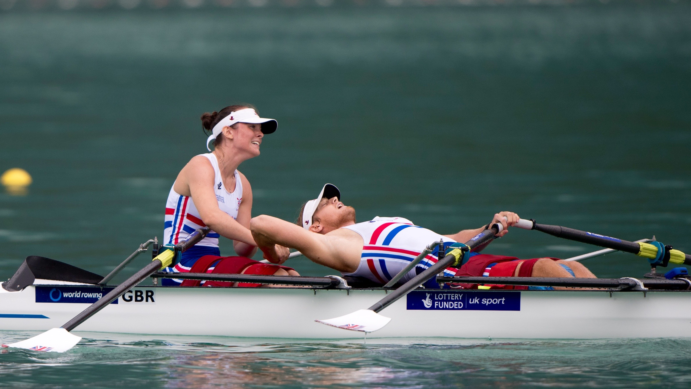Lauren Rowles and Laurence Whiteley celebrate after winning silver at the 2015 World Championships in Aiguebelette