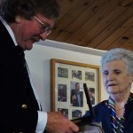 Dame Di Ellis presents Greg Gregory-Jones with his Medal of Honour
