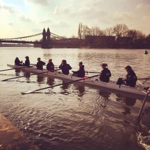 Women's eight afloat by Hammersmith Bridge