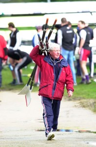 Ron Needs, former GB Rowing Coach carrying blades