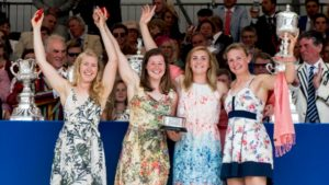 Mathilda Hodgkins-Bryne, Melissa Wilson, Holly Nixon and Jess Leyden lift the Princess Grace Challenge Cup © Henley Royal Regatta