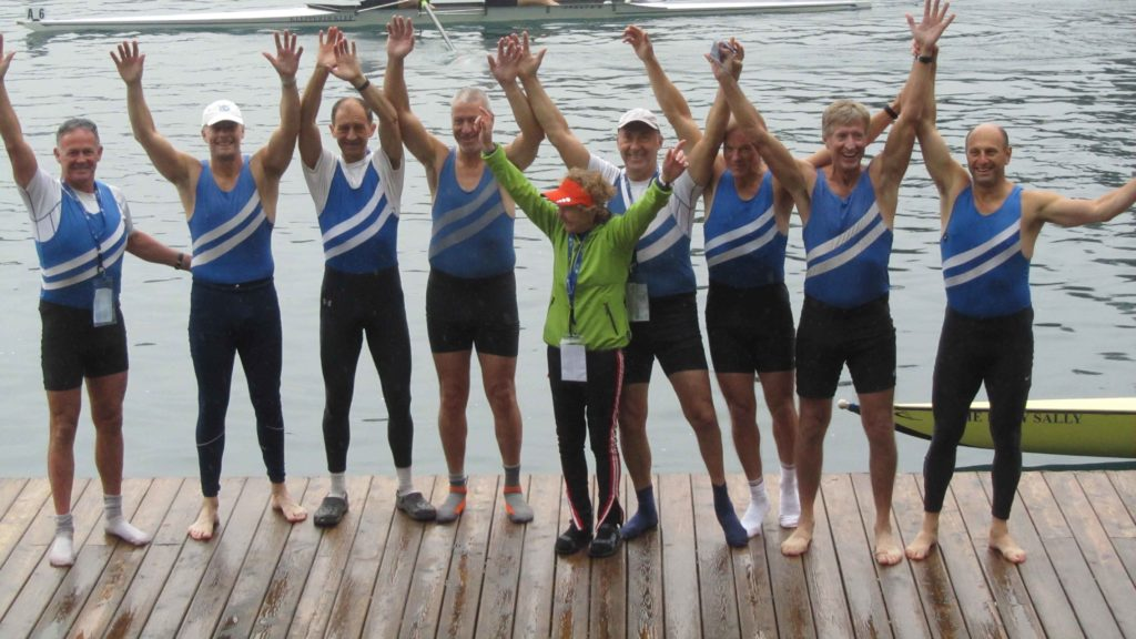 Quintin BC men's eight Masters E celebrating on the pontoon after winning gold at the World Rowing Masters Regatta